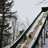 KRISTOPHER RADDER - BRATTLEBORO REFORMER <br /> Drew Christiansen and Ryan Jones, of Evans Construction, work on slimming the inrun at the Harris Hill Ski Jump.