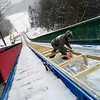 KRISTOPHER RADDER - BRATTLEBORO REFORMER <br /> Jeff Kneeland, of Evans Construction, works on tracking down the tack at the Harris Hill Ski Jump.