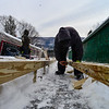 KRISTOPHER RADDER - BRATTLEBORO REFORMER <br /> Jeff Kneeland, of Evans Construction, puts in the footings of the new wood frame for the inrun at the Harris Hill Ski Jump.