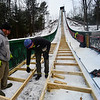 KRISTOPHER RADDER - BRATTLEBORO REFORMER <br />  Ian Clews, of Clews Construction, and Drew Christiansen, of Evans Construction, work on slimming the inrun at the Harris Hill Ski Jump.