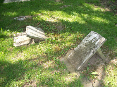 NIKKI RHOADES / GAZETTE Decades of weather conditions have affected tombstones and markers at Windfall Cemetery in Medina Township.