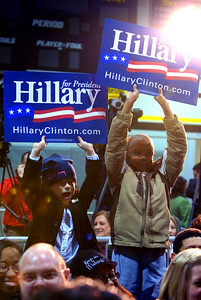 Six year old John Clay Bare, of Portersdale, (left) and eight year old Terrence Burkes, of Kennesaw, show their support for Hillary Clinton before former President Bill Clinton takes the stage at Kennesaw State University Frinday night.