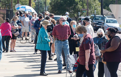 People wait in line to cast their votes at The HUB in downtown Tyler on Tuesday, Oct. 13, 2020 in Tyler, Texas for early voting for the November presidential election. Polls opened Tuesday in Texas for early voting.