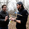 "Doug Hill, of Lafayette, right, talks with Aaron Pirnack, of Longmont, about the tools needed to build a fire without matches or a lighter during a primitive skills class on Friday, Dec. 15, in Boulder. For a video on how to start a fire without matches go to  <a href=""http://www.dailycamera.com"">http://www.dailycamera.com</a><br />  Jeremy Papasso/ Camera"