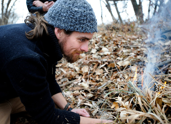 "Doug Hill, of Lafayette, demonstrates how to build a fire to Aaron Pirnack, of Longmont, during a primitive skills class on Friday, Dec. 15, in Boulder. For a video on how to start a fire without matches go to  <a href=""http://www.dailycamera.com"">http://www.dailycamera.com</a><br />  Jeremy Papasso/ Camera"