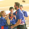 Bryce Johnson (right) is congratulated by coach Mindy Johnson for an 814 combined score earlier this year during a senior recognition, Tuesday, Jan 17.