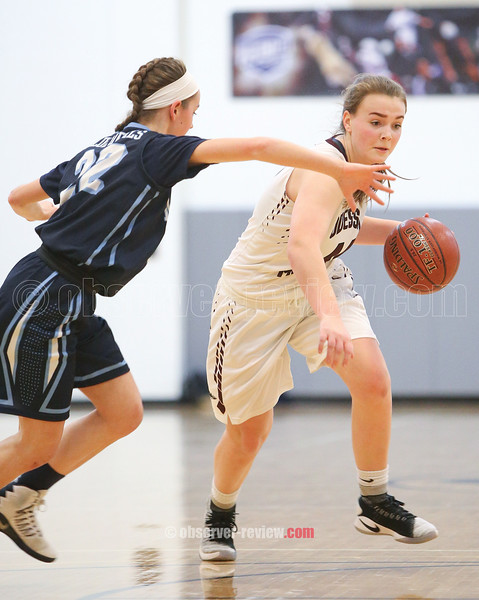 Gillian Clark drives to the basket in the IAC Small School championship game.