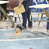 Andy Fudala looks at the times on the scoreboard at the sectional prelims, Wednesday, Feb. 15.  He won the 100 breaststroke in the finals.