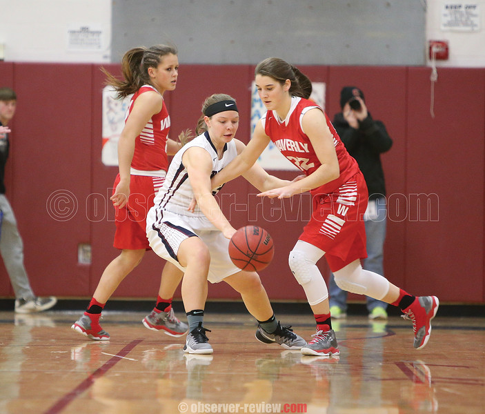 Clara Chedzoy challenges the Waverly offense, Friday, Feb. 3.