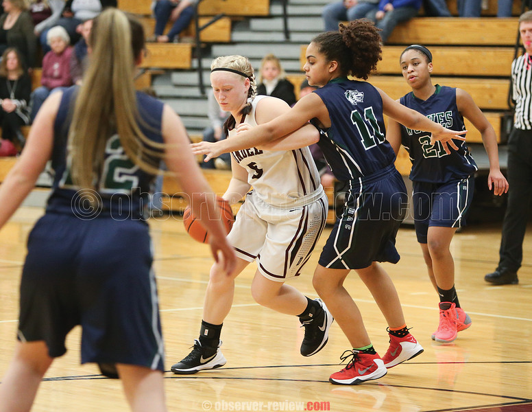 Alyssah Newell works to split the defense Saturday, Feb. 4 at Dundee.