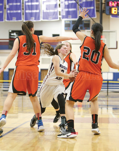 Hannah Morse tries to maneuver between three defenders in the quarterfinal game.