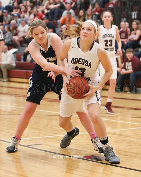 Grace Vondracek tries to protect the ball from a Elmira Notre Dame player, Friday.