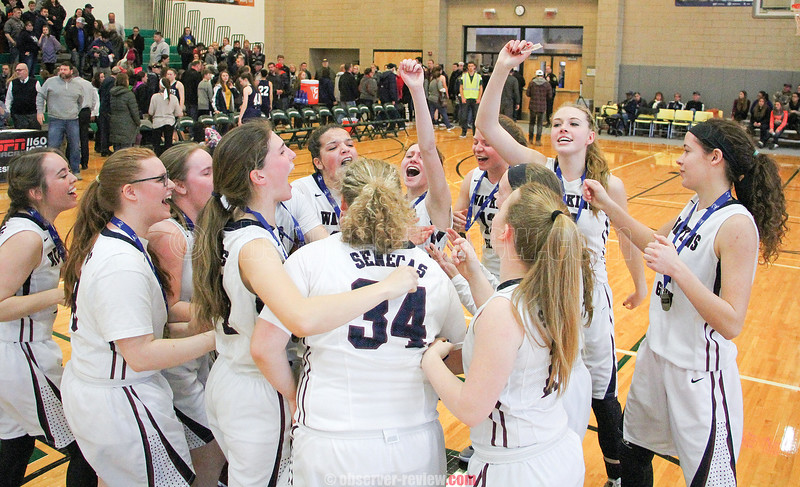 The Watkins Glen girls basketball team celebrates winning their third consecutive sectional title Saturday, March 4.