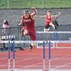 Josh Cramer runs in the 400 meter hurdles event Tuesday, April 11.
