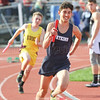 Gabe Planty runs for Watkins Glen in a relay race at Bath, Friday, April 21.