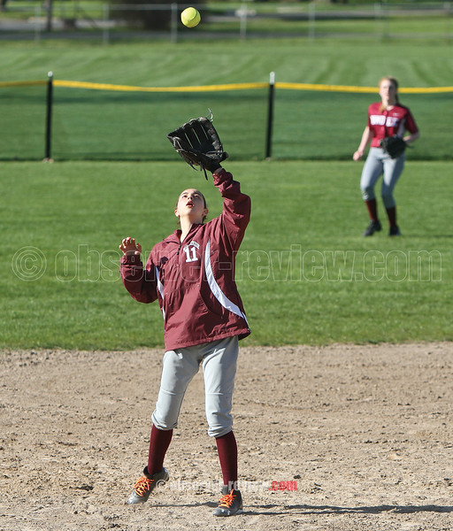 Mackenzie Strait catches a fly ball at third base, Monday.