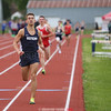Aaron Planty runs to victory in the 1600 meter run, Friday night.