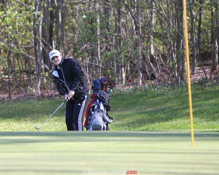 Gillian Clark chips up to the green at the Watkins Glen Golf Course.