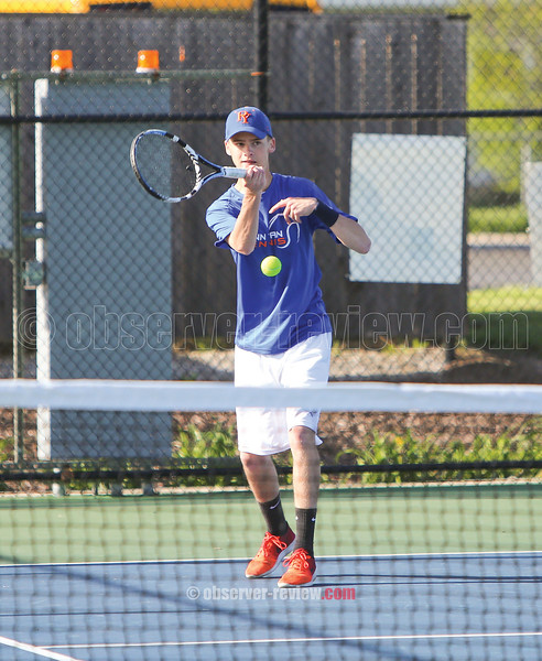 Jack Arnold returns the ball during the Wednesday, May 10 match.