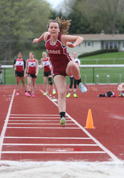 Elizabeth Medina competes in the triple jump event last Tuesday.