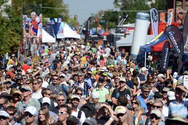 Spectators fill Pearl Street, looking east from 15th Street, to watch the USA Pro Cycling Challenge on a large television screen in Boulder Saturday Aug. 25, 2012. (Lewis Geyer/Boulder Daily-Camera)