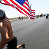 "Alan Villavicencio runs with the American flag in front of the peloton during a section of Stage 6 of the USA Pro Challenge on Saturday, Aug. 25. For more photos and video of the race go to  <a href=""http://www.dailycamera.com"">http://www.dailycamera.com</a><br /> Jeremy Papasso/ Camera"