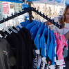 Brandi Thomas straightens jerseys for sale in the Garmin-Sharpe vendor tent on Pearl Street during the USA Pro Cycling Challenge in Boulder Saturday Aug. 25, 2012. (Lewis Geyer/Boulder Daily-Camera)