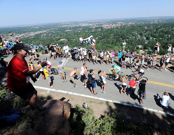 "Fans line the side of Flagstaff Road to watch the final stretch of Stage 6 during the USA Pro Challenge on Saturday, Aug. 25. For more photos and video of the race go to  <a href=""http://www.dailycamera.com"">http://www.dailycamera.com</a><br /> Jeremy Papasso/ Camera"