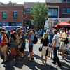 Fans wait in line at the will call/ticket tent on Pearl Street, near 17th, before the USA Pro Cycling Challenge enters Boulder Saturday Aug. 25, 2012. (Lewis Geyer/Boulder Daily-Camera)