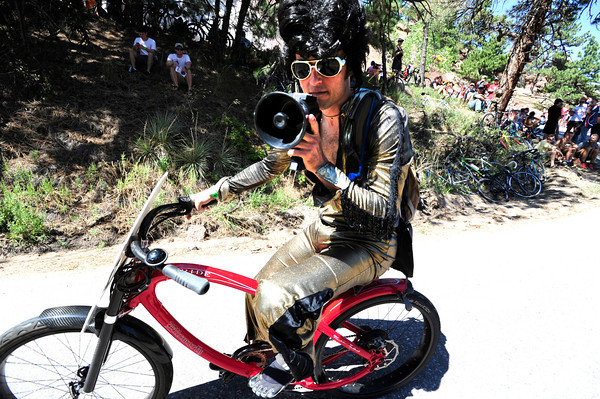 Steven D dressed as Elvis rides on Flagstaff Mountain on the finishing climb of the Pro Cycling Challenge in Boulder.<br /> Photo by Paul Aiken