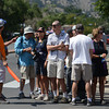 A marshall moves onlookers off of Canyon Boulevard before the street is closed for the USA Pro Cycling Challenge in Boulder Saturday Aug. 25, 2012. (Lewis Geyer/Boulder Daily-Camera)