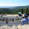 "Barry Sparks, of, Boulder, right, takes photos of the peloton from the top of a rock during a section of Stage 6 during the USA Pro Challenge on Saturday, Aug. 25. For more photos and video of the race go to  <a href=""http://www.dailycamera.com"">http://www.dailycamera.com</a><br /> Jeremy Papasso/ Camera"