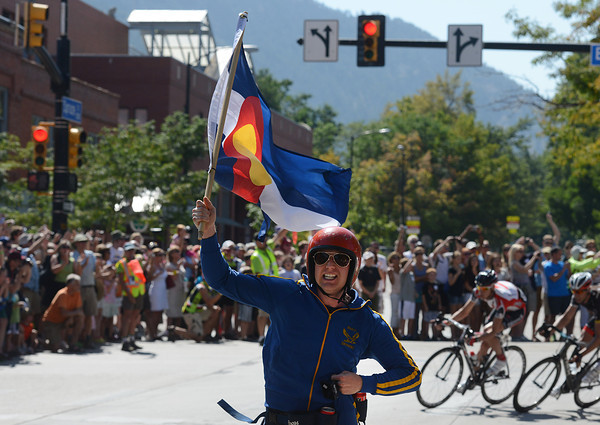 """Captain Colorado"" runs in front of the leaders as they go around the corner from Broadway onto Spruce during the USA Pro Cycling Challenge in Boulder Saturday Aug. 25, 2012. (Lewis Geyer/Boulder Daily-Camera)"