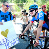 Brady Kappious chats with his friend and rider Alex Howes after Howes stopped on the way down Flagstaff Mountain to talk to his fan club after the finishing climb of the Pro Cycling Challenge in Boulder.<br /> Photo by Paul Aiken