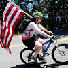 Claire Thayer rides up on Flagstaff Mountain to view the finishing climb of the Pro Cycling Challenge in Boulder.<br /> Photo by Paul Aiken