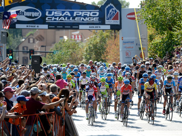 """Cyclists speed out of the start gate in Golden during the USA Pro Challenge on Saturday, Aug. 25. For more photos and video of the race go to  <a href=""""http://www.dailycamera.com"""">http://www.dailycamera.com</a><br /> Jeremy Papasso/ Camera"""