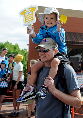 """Carter Pearson, 3, sits on his father, Wes Pearson's shoulders to watch the start of the Stage 6 race in Golden during the USA Pro Challenge on Saturday, Aug. 25. For more photos and video of the race go to  <a href=""""http://www.dailycamera.com"""">http://www.dailycamera.com</a><br /> Jeremy Papasso/ Camera"""