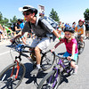 Kalea Zeender gets a pull from her dad Ryan as they move up on Flagstaff Mountain to view the finishing climb of the Pro Cycling Challenge in Boulder.<br /> Photo by Paul Aiken