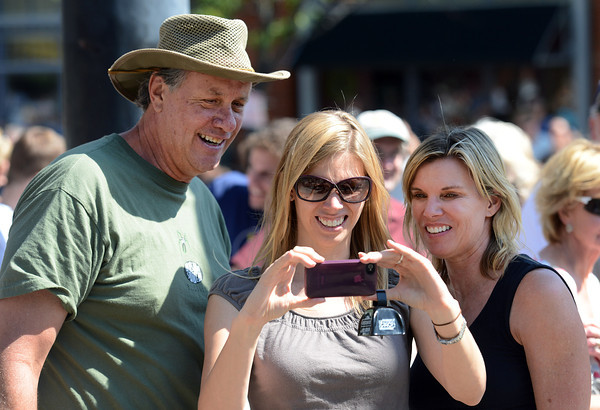 John Ellwood, left, and his wife Wendy, Ellwood, right watch the video their daughter Natasha Ellwood captured at the intersection of Broadway and Spruce during the USA Pro Cycling Challenge in Boulder Saturday Aug. 25, 2012. (Lewis Geyer/Boulder Daily-Camera)