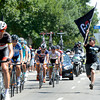 "Edwin Perez runs beside the Peloton with a Team Radio Shack flag during the USA Pro Challenge on Saturday, Aug. 25. For more photos and video of the race go to  <a href=""http://www.dailycamera.com"">http://www.dailycamera.com</a><br /> Jeremy Papasso/ Camera"