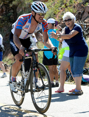 "A woman cheers for Alexander Mironov as he climbs Flagstaff Road towards the finish of Stage 6 during the USA Pro Challenge on Saturday, Aug. 25. For more photos and video of the race go to  <a href=""http://www.dailycamera.com"">http://www.dailycamera.com</a><br /> Jeremy Papasso/ Camera"