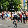 Spectators cheer for Alexander Mironov as he races east on Spruce Street during the USA Pro Cycling Challenge in Boulder Saturday Aug. 25, 2012. (Lewis Geyer/Boulder Daily-Camera)