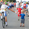 "Owen Beneski, 3, high-five's cyclist Serghei Tvetcov at the USA Pro Cycling start in Golden on Saturday, Aug. 25. For more photos and video of the race go to  <a href=""http://www.dailycamera.com"">http://www.dailycamera.com</a><br /> Jeremy Papasso/ Camera"
