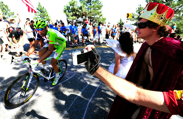 Paolo Longo Borghini is cheered on by Chris Baddock of Devon England  on Flagstaff Mountain on the finishing climb of the Pro Cycling Challenge in Boulder.<br /> Photo by Paul Aiken