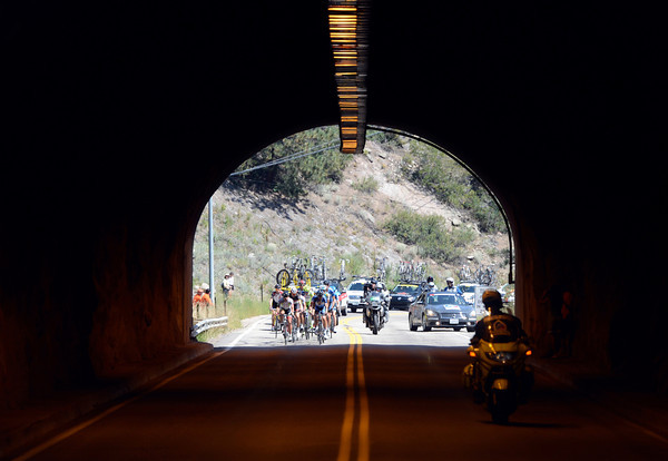 "Riders in the Peloton enter a tunnel during the USA Pro Challenge on Saturday, Aug. 25. For more photos and video of the race go to  <a href=""http://www.dailycamera.com"">http://www.dailycamera.com</a><br /> Jeremy Papasso/ Camera"