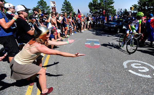 Spectators cheer on Benjamin Moreno Moser on Flagstaff Mountain on the finishing climb of the Pro Cycling Challenge in Boulder.<br /> Photo by Paul Aiken