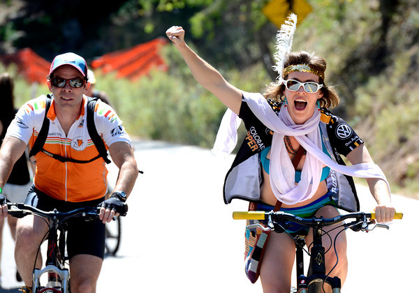 Erin Newton cheers to the spectators on Flagstaff Mountain on the finishing climb of the Pro Cycling Challenge in Boulder.<br /> Photo by Paul Aiken
