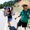 David and Lydia Nevarez  cheer on the riders and walkers on Flagstaff Mountain to view the finishing climb of the Pro Cycling Challenge in Boulder.<br /> Photo by Paul Aiken