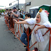 "Zane Senft, 11, waves to cyclists on their way to check in while dressed as a chicken at the start gate in Golden during Stage 6 of the USA Pro Challenge on Saturday, Aug. 25. For more photos and video of the race go to  <a href=""http://www.dailycamera.com"">http://www.dailycamera.com</a><br /> Jeremy Papasso/ Camera"