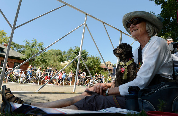 Joan Schweizer and Ollie wait for the USA Pro Cycling Challenge to travel down 17th Street in Boulder Saturday Aug. 25, 2012. (Lewis Geyer/Boulder Daily-Camera)